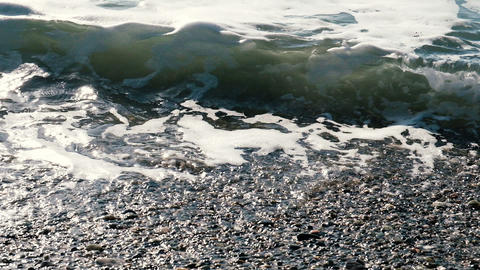 Sea waves on a sunny day on the shore in slow motion close-up Footage
