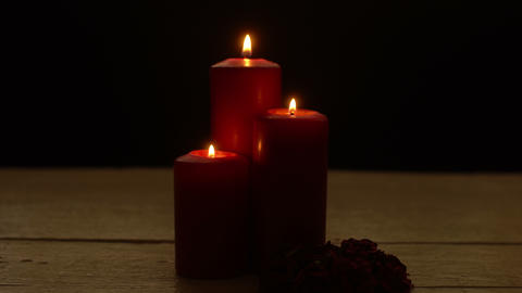 Three red candles lights with rose Footage