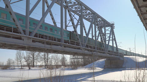 Train rides in winter on the railway bridge Footage