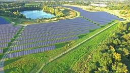 Aerial shot of solar power plant with beautiful lake in the middle Footage