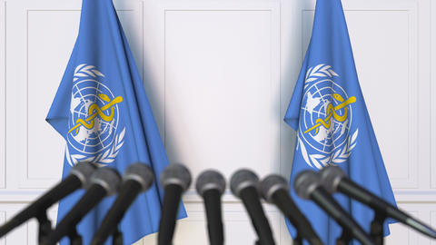 World Health Organization WHO official press conference. Flags and microphones Footage
