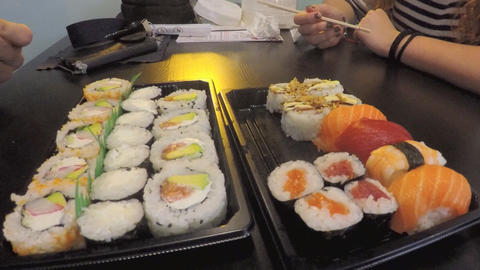 Sushi Restaurant Couple Eating Stock Video Footage