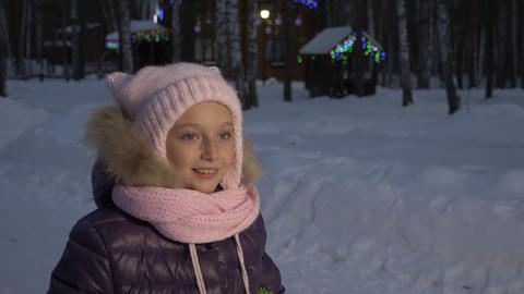 Portrait little girl walking on evening cottage village on Christmas eve Footage
