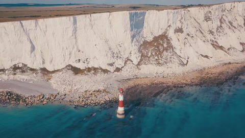 White chalk cliffs and aerial view Lighthouse Beachy Head, Eastbourne, East Footage