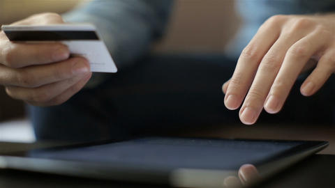 Shopping on-line with credit card on digital tablet Footage