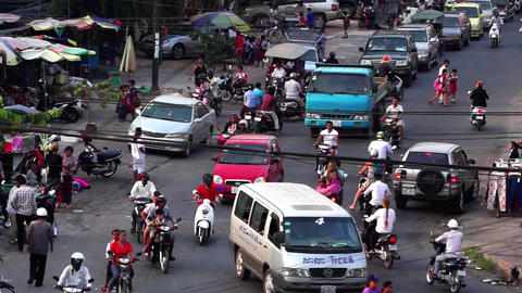A typical S.E. Asia Street intersection at rush hour Footage