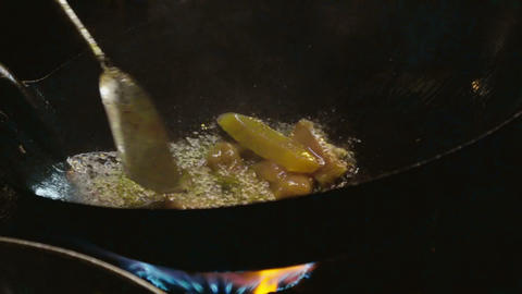 slow motion video of a man cooking vegetables Footage