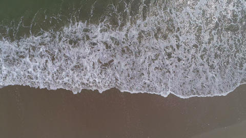 Sea waves on beach in summer, aerial view Live Action
