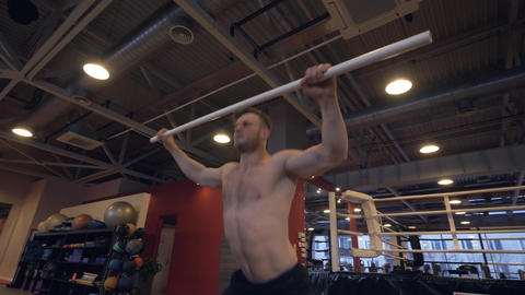 Muscular man training with light crossbar, squat exercise and lifting exercise Footage