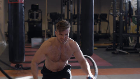 Man training with ropes during crossfit workout. Crossfit and functional Footage