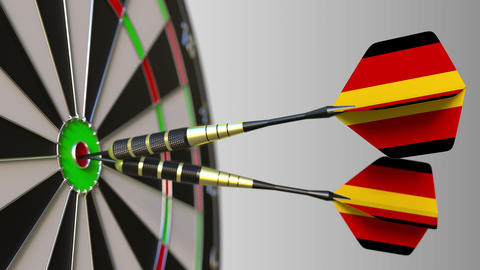 German national achievement. Flags of Germany on darts hitting bullseye Live Action