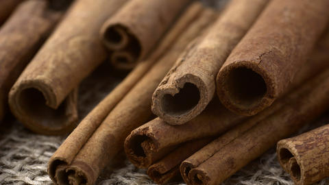 Cinnamon bark sticks low angle shallow depth of field rotating Live Action
