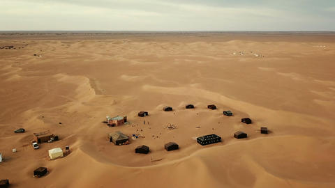 Flying over camping site in Sahara desert, Africa Footage