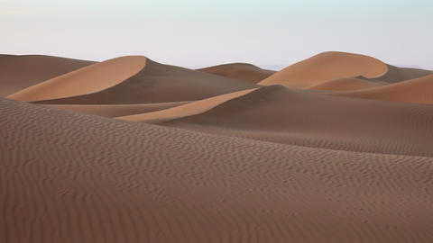 Sand blowing in sand dunes in wind, Sahara desert Live Action
