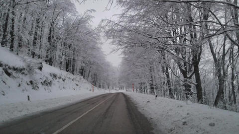 Winter road through the mountain Footage