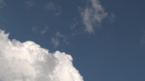 Jet airliner passing through the spring fluffy clouds 1 Footage