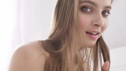 Portrait of young caucasian sexy girl touching lips, smiling, temptation, white Footage