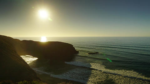 Legzira beach with arched rocks, sunset timelapse Live Action
