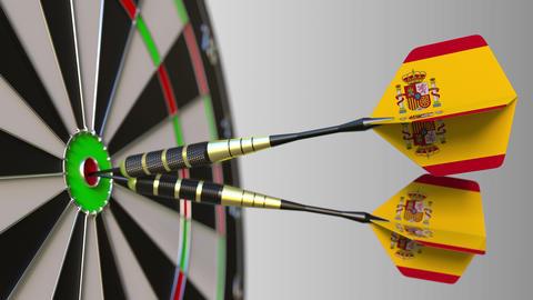 Spanish national achievement. Flags of Spain on darts hitting bullseye Live Action