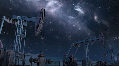 Looped move along oil pump jacks under night sky Animation