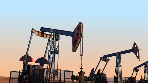 Looped move along oil pump jacks against clear sky Animation