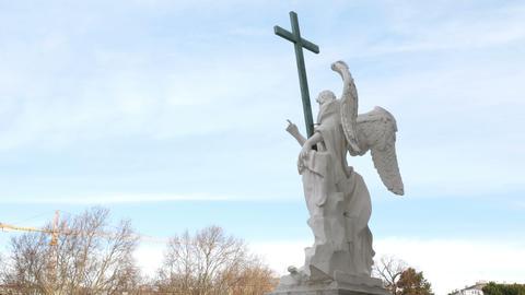 statue of an angel carved in marble, Karlsplatz church Vienna, Austria Footage