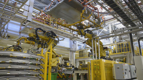 Automobile plant, industrial robots on the automatic assembly line Footage