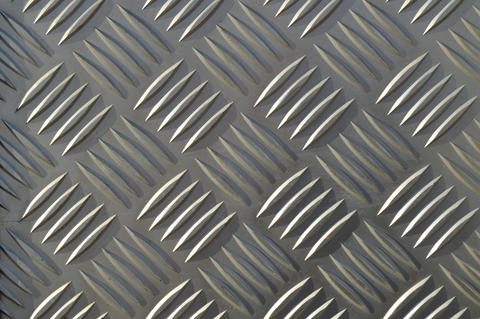 Background of metal with repetitive patterns diamonds Fotografía