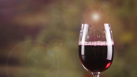 Close up red wine in glass with bursting bubble slow motion. One wine glass Footage