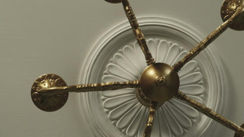 An old bronze chandelier on the ceiling Live Action