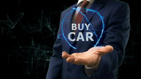 Businessman shows concept hologram Buy car on his hand Footage