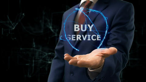 Businessman shows concept hologram Buy service on his hand Footage