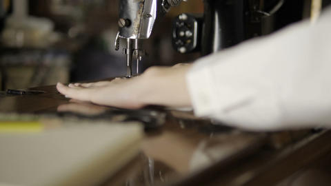 Hand female sews fabric with old sewing machine Live Action