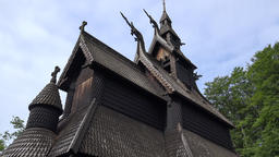 Norway City Of Bergen Fantoft wooden stave church against cloudy sky Footage