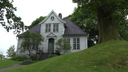 Norway Gamle Bergen old white Norwegian villa at a green hill Footage