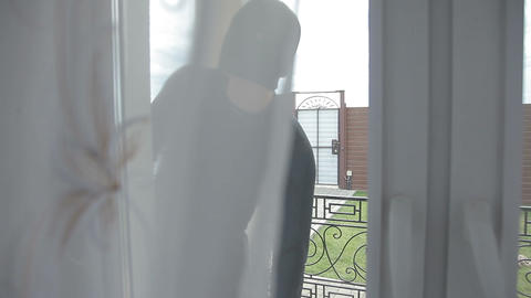 Burglar wearing black clothes coat or Thief breaking into a house via a patio Live Action