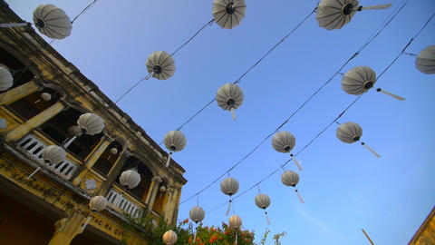 Traditional Vietnamese lanterns hanging over a street Live Action