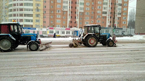 Lipetsk, Russian Federation - January 20, 2018: A team of tractors to clean the Footage