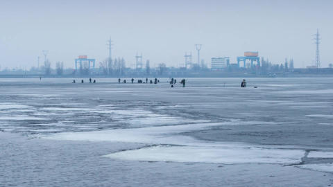 Time lapse with zoom effect of winter fishermen angling on ice Footage