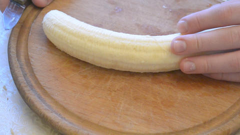 Quick cutting of banana in slices Footage