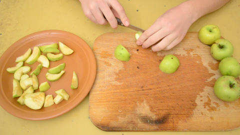 Removing apple kernels and cutting apples to slices Footage