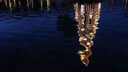 Illuminated decorated New Year tree reflected in the water Footage