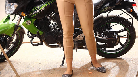 Female Legs front of vehicle Tyre Footage