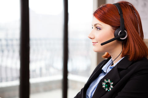 Smiling customer support line worker Photo