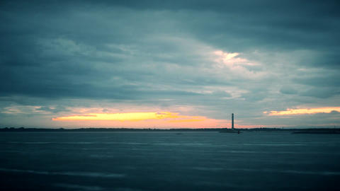 Timelapse with lighthouse during daybreak with colorful clouds Footage