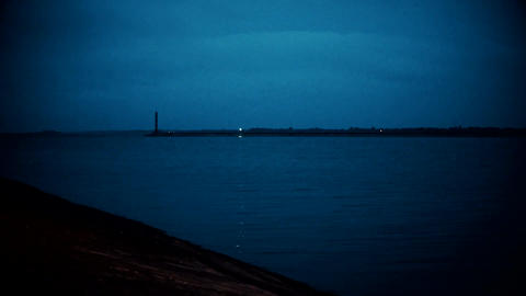 Blinking lighthouse at night Footage