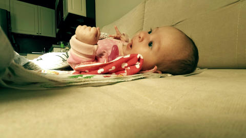 Newborn baby girl trying to sleep, funny time lapse video Footage