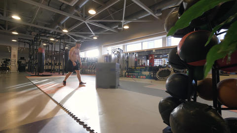 Athlete man jumping on platform on crossfit training in fitness club slow motion Live Action