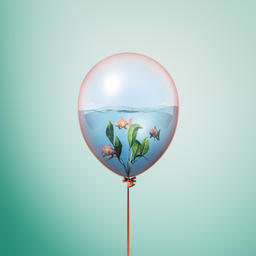 Minimal balloon concept with small gold fish swimming inside Fotografía