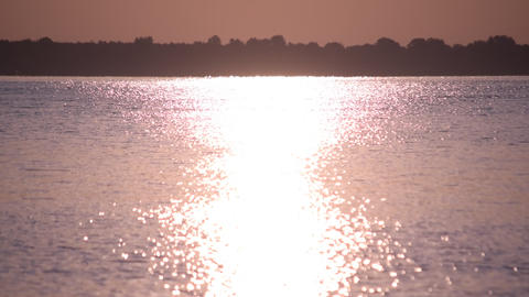 Sunshine reflected in water of lake or river forming a sun path or way of light Footage